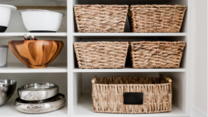 Image of a cupboard with baskets and pans for the blog post How to Win at Decluttering