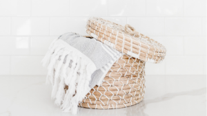 Image of a laundry hamper for the blog post How to Win at Decluttering