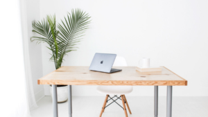 Image of a desk with a laptop on it for the blog post Why You Should be Setting Intentions as Well as Setting Goals