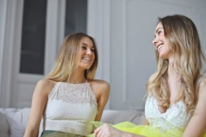 Image of two women laughing and chatting for the blog post How to Reignite Your Passion in Life