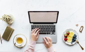 Image of a woman using her laptop for the blog post How to Feel Like You Have it All Together...Even Though You Don't.