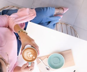 Image of a woman drinking coffee for the blog post How to Feel Like You Have it all Together...Even Though You Don't