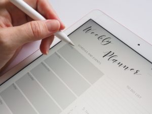Image of a woman using her iPad for the blog post Positive Coping Skills to Crush Stress and Anxiety