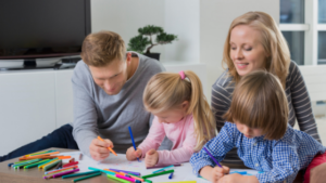 Image of a family colouring together for the blog post Back to School Goals for Students and Parents