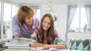 Image of a mother helping her daughter with her homework for the blog post Back to School Goals for Students and Parents