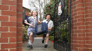 Image of two children running out of school gates for the blog post Back to School Goals for Students and Parents
