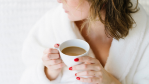 Image of a woman drinking tea for the blog post Five of the Best Cheap and Easy Self-Care Ideas