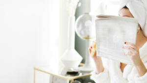 Image of a woman reading a magazine for the blog post Five of the Best Cheap and Easy Self-Care Ideas