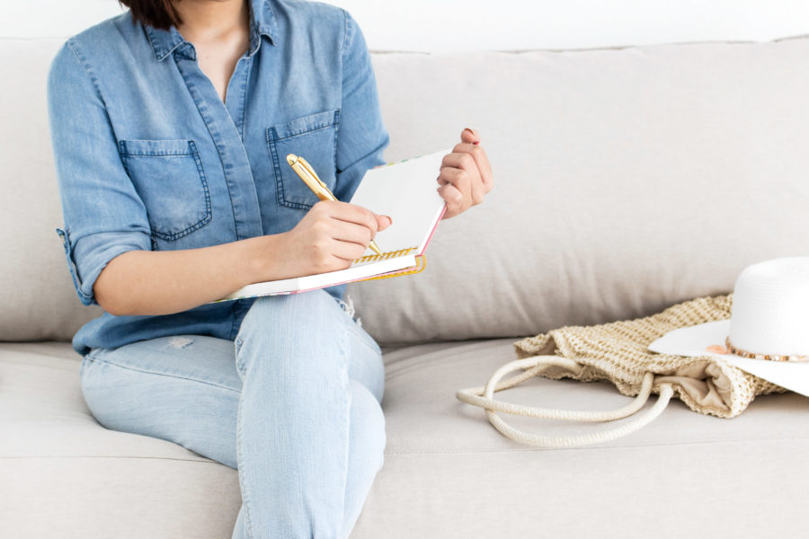 Image of a woman journaling for the blog post Self-Care Challenge: 7 Days to Better Self-Care