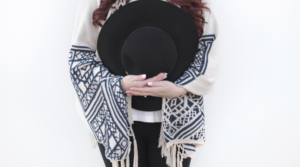 Image of a woman holding a hat for the blog post Become a Better You in 2020