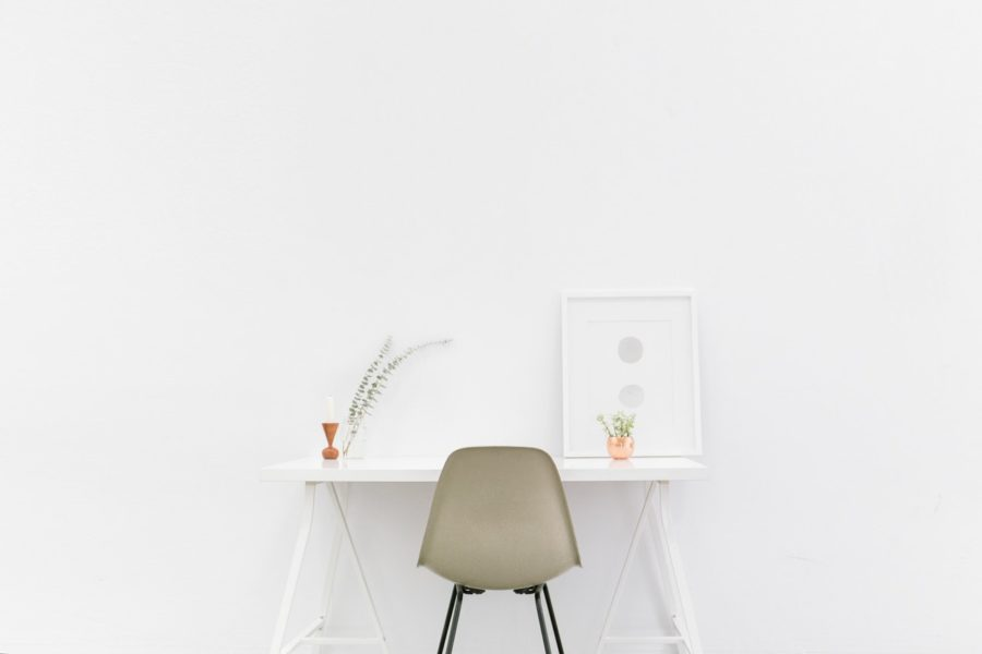 Image of a minimalist desk and chair for the blog post How to Lead a More Minimalist Lifestyle