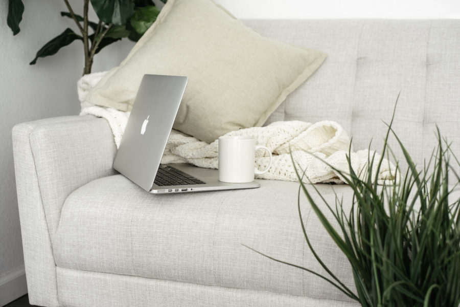 Image of a laptop on a sofa for the blog post What I Learned from my 30-Day Minimalism Challenge