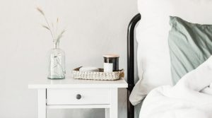 Image of a bedside table and bed for the blog post The 30-Day Decluttering Challenge