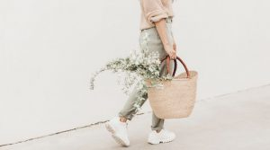 Image of a woman carrying a bag with flowers in