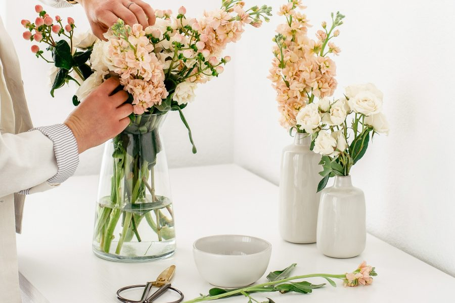 Image of a woman arranging a bunch of flowers for the blog post Powerful Quotes About Gratitude and Appreciation