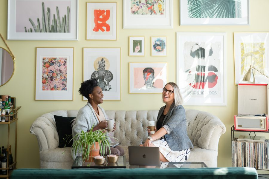 Image of two women talking during a life coaching session for the blog post What is a Life Coach and the Nine Benefits of Hiring One